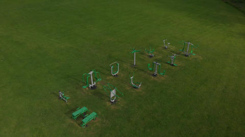 Outdoor exercise equipment in a field (V453) Live Action