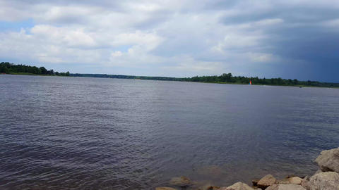 View of Lake Scenery With Wind Sailing Boats and Jet skis in the Distance. Lakeside Shore and Water Footage