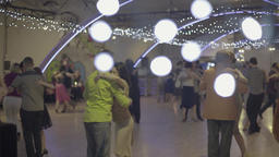 A group of people dancing tango (milonga) in a romantic atmosphere Footage