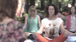 A group of women practice yoga (meditating). Slow motion Footage