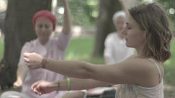 Girl doing yoga in the Park day . Slow motion Footage
