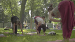 Yoga in the Park day. People are practicing yoga Stock Video Footage
