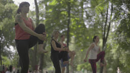 Yoga in the park in the afternoon Footage