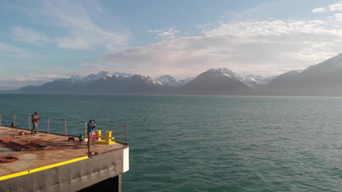 Fishing off a barge in Alaska for salmon Live Action
