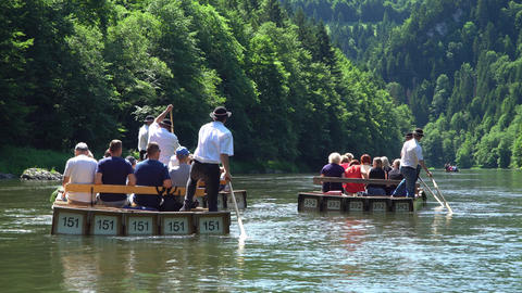 Poland, Dunajec River June 2019. Rafting tourists on boats on the river Footage