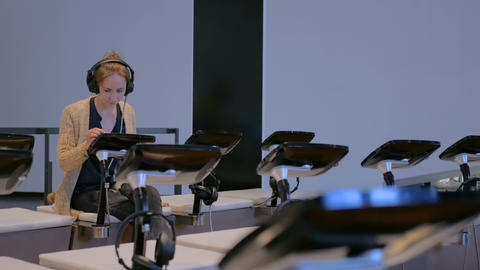 Woman using interactive touchscreen display at modern... Stock Video Footage