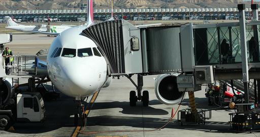 Airbus A330 Plane On Tarmac With Boarding Bridge GIF