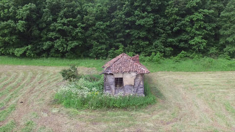Flight above the old abandoned house in the middle of the meadow Footage