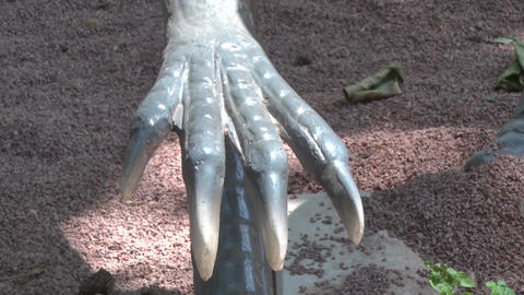 Realistic coelophysis dinosaur in dino park one hand with claws Footage