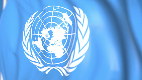 Waving national flag of the United Nations organization UN close-up, editorial Live Action