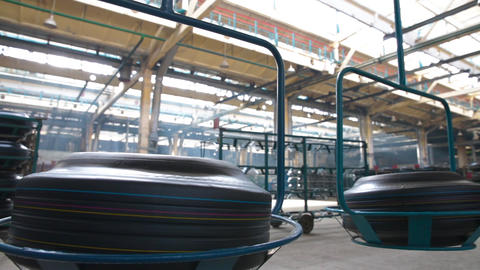 Movement of tires on the overhead conveyor Live Action