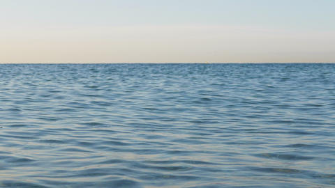 Sea view on the Nice summer day with clear horizon. Blue sea surface close up Live Action