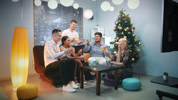 Cheerful company celebrating winter holidays with sparklers and dry ice Footage