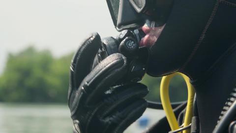 scuba diver preparing to dive. Portrait of a scuba diver with all of the Live Action