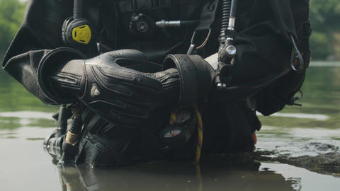 a diver in the water. A diver inspects the bottom. scuba diver. scuba diver in Live Action