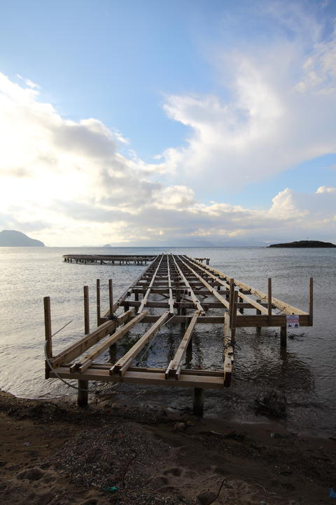 Old abandoned wooden fishing pier on the river in the countryside Photo