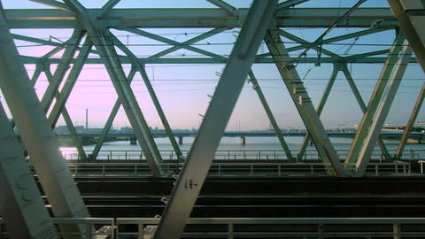 Railway car window. Travel on the iron bridge ビデオ