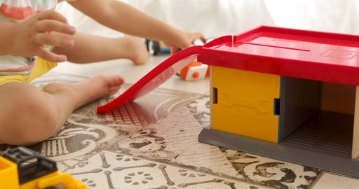 Crop child play with wooden toy cars Footage