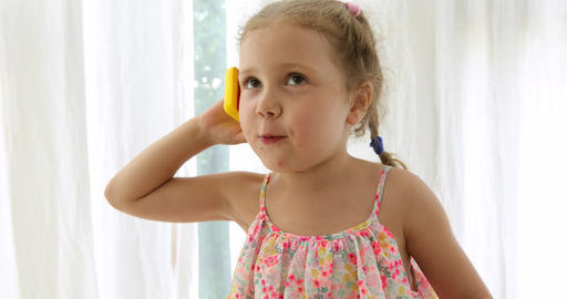 Emotional girl talking on an toy phone Footage