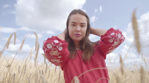Portrait tender lovely young woman enjoying nature and sunlight in wheat field Footage