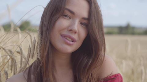 Portrait young woman enjoying nature and sunlight in wheat field at incredible Footage