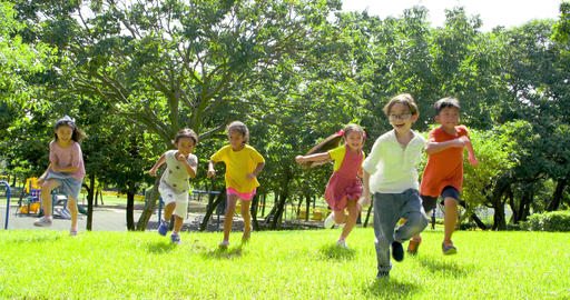 Multi-ethnic group of school children laughing and running Live Action