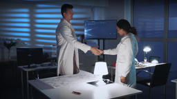 Two diverse scientists giving hands in greeting on the meeting in lab Footage