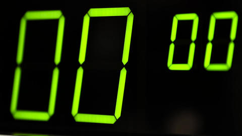 Macro digital watch counter timer. Green digit Footage