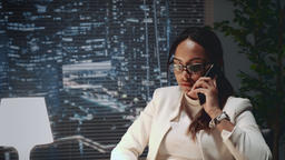 Close up of multiracial business lady speaking by smartphone Footage