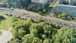 Ecology Contrast: Aerial Cityscape with Skysrapers and Busy Road vs Green Park Footage