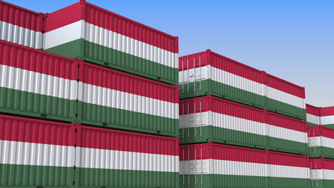 Container terminal full of containers with flag of Hungary. Hungarian export or Live Action