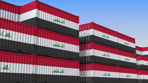 Container terminal full of containers with flag of Iraq. Iraqi export or import Live Action