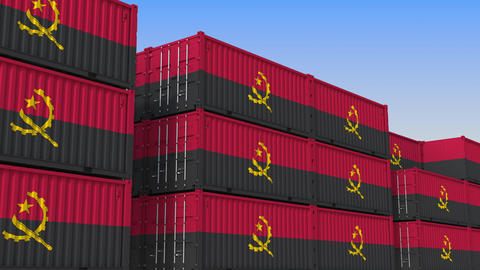 Container terminal full of containers with flag of Angola. Angolan export or Live Action