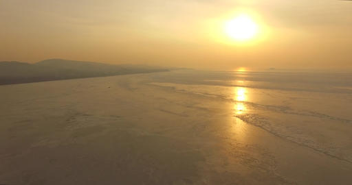 Aerial view of the sunset over the icy surface of the Amur Bay. Vladivostok, Russia Live Action