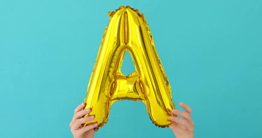 Gold foil letter A celebration balloon Footage