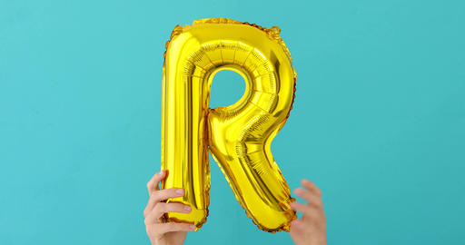 Gold foil letter R celebration balloon Footage