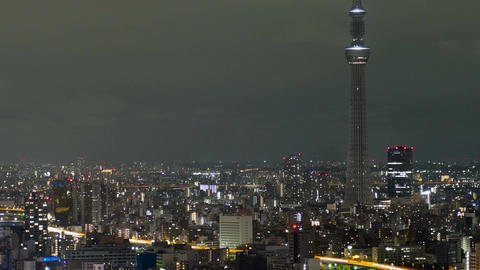 Motion (pan) timelapse of city lights surrounding the Tokyo Skytree Footage