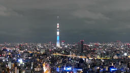 Motion (zoom out) timelapse of city lights surrounding the Tokyo Skytree Footage