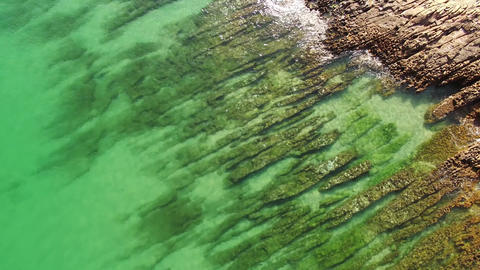 Beautiful Emerald ocean sea wave on a rocky beach aerial view Footage
