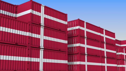 Container yard full of containers with flag of Denmark. Danish export or import Live Action