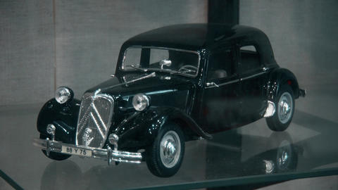 Toy of an old and retro car of the 20th century Live Action
