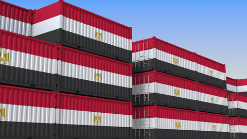 Container terminal full of containers with flag of Egypt. Egyptian export or Live Action
