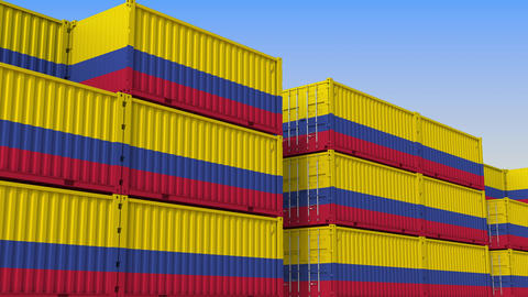 Container terminal full of containers with flag of Colombia. Colombian export or Live Action