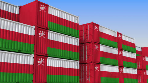 Container yard full of containers with flag of Oman. Omani export or import Live Action