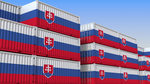 Container yard full of containers with flag of Slovakia. Slovak export or import Live Action