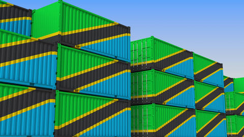 Container yard full of containers with flag of Tanzania. Tanzanian export or Live Action
