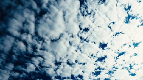 Fluffy white clouds blue sky time lapse motion background Live Action