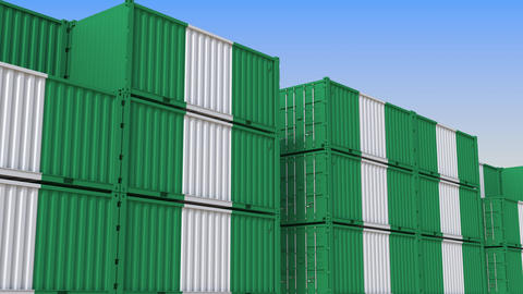 Container yard full of containers with flag of Nigeria. Nigerian export or Live Action