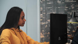 Close-up. Beautiful woman as a video editor working in post production studio Footage