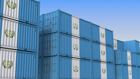 Container yard full of containers with flag of Guatemala. Guatemalan export or Live Action